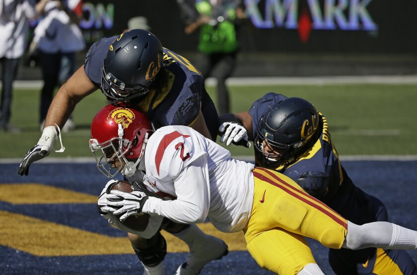 Southern California cornerback Adoree' Jackson (2) scores a touchdown after making a 46-yard interception during the second half of an NCAA college football game against California, Saturday, Oct. 31, 2015, in Berkeley, Calif. USC won the game 27-21. Making the stop are California offensive linemen