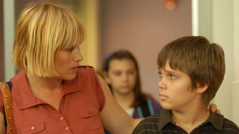 """Olivia (Patricia Arquette) and Mason (Ellar Coltrane) in the movie """"Boyhood,"""" directed by Richard Linklater."""