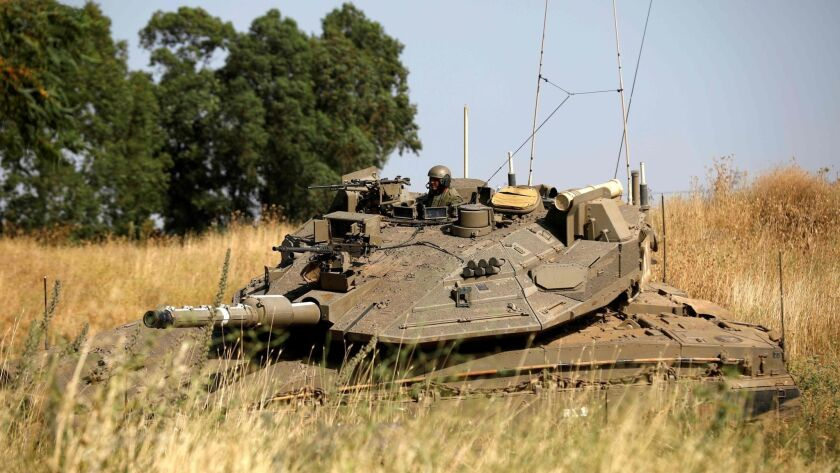 Israeli soldiers maneuver a Merkava tank in the Israeli-annexed Golan Heights on June 2.