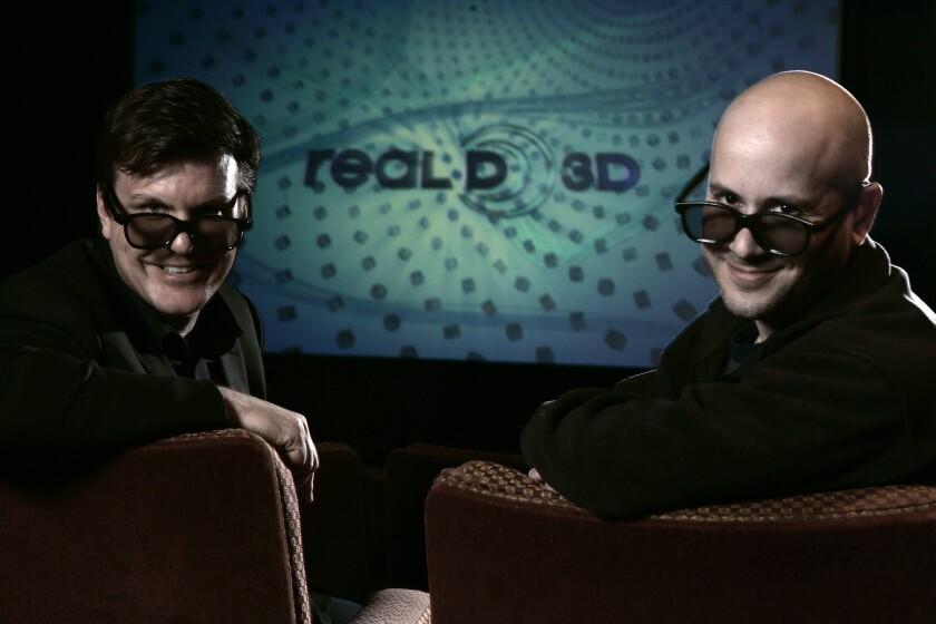 RealD founders Michael Lewis, left, and Josh Greer wearing 3–D glasses inside their theatre at their Beverly Hills headquarters in 2009.