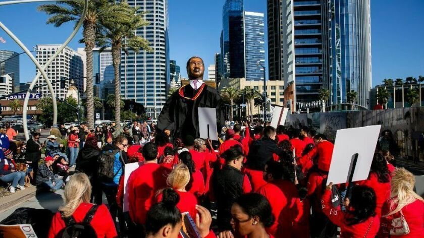A group from San Diego City College marches in the Martin Luther King Jr. Parade along West Broadway Monday.
