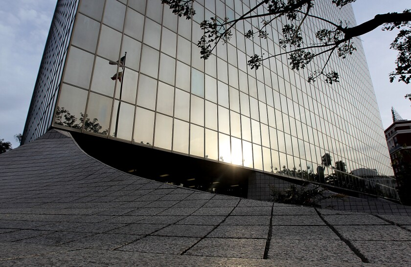 A sunset reflects off of the Los Angeles County Superior Court building as seen from the front plaza in 2011.