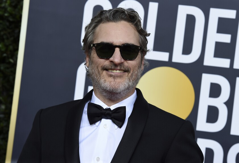 """FILE - In this Sunday, Jan. 5, 2020 file photo, Joaquin Phoenix arrives at the 77th annual Golden Globe Awards at the Beverly Hilton Hotel on in Beverly Hills, Calif. The film """"Joker"""" has topped the nominations for the British Academy film awards announced on Tuesday Jan. 7, 2020. The awards will be announced at a gala event hosted by Graham Norton on February 2. (Photo by Jordan Strauss/Invision/AP, File)"""