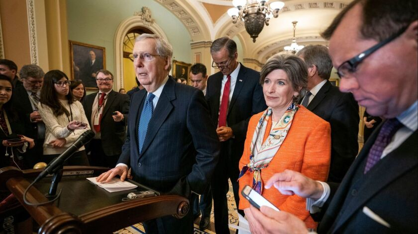 Senate Majority Leader Mitch McConnell (R-Ky.) and several members of the Senate Republican caucus meet with reporters in the U.S. Capitol March 5.
