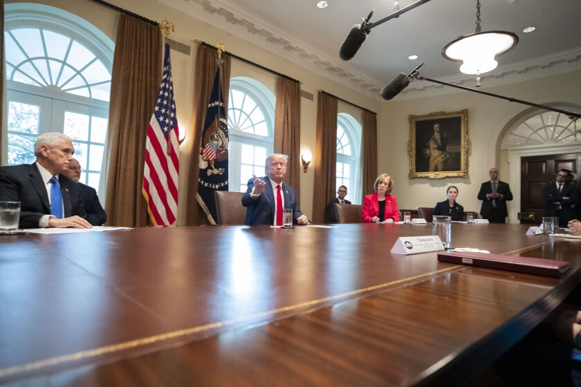 President Trump speaks with nurses representatives in the Cabinet Room