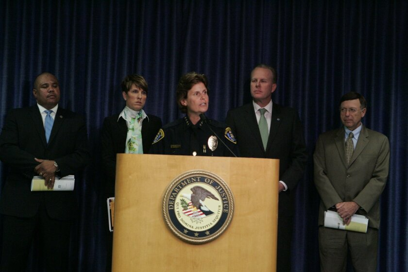 San Diego Police Chief Shelley Zimmerman discusses the results of a federal review of policies and practices of her department in a news conference at the U.S. Attorney's offices in downtown San Diego. From left,  Ronald Davis, director of the U.S. Department of Justice's Office of Community Orient