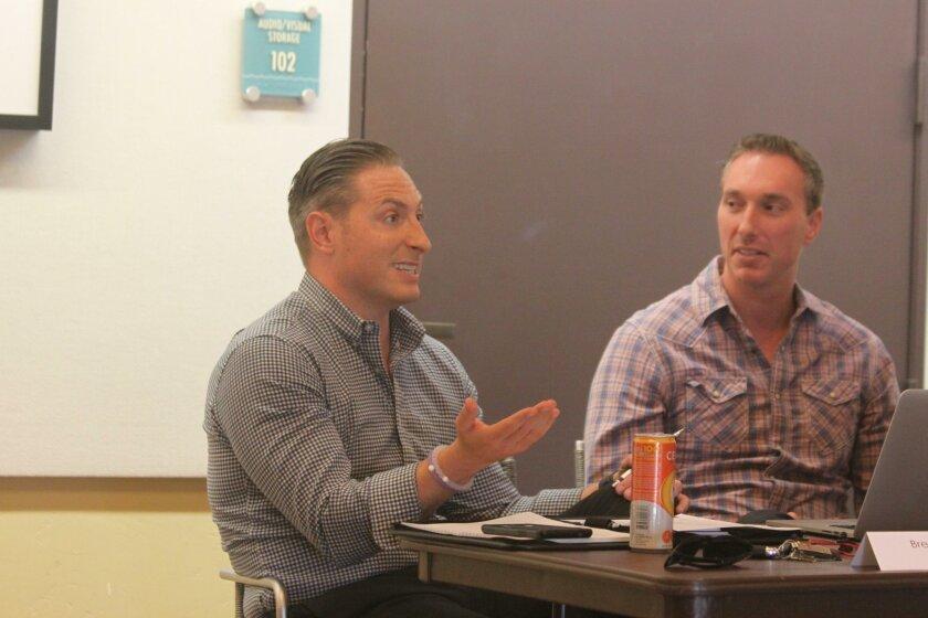 Village Merchants Association member Brett Murphy speaks in favor of the proposed MAD.