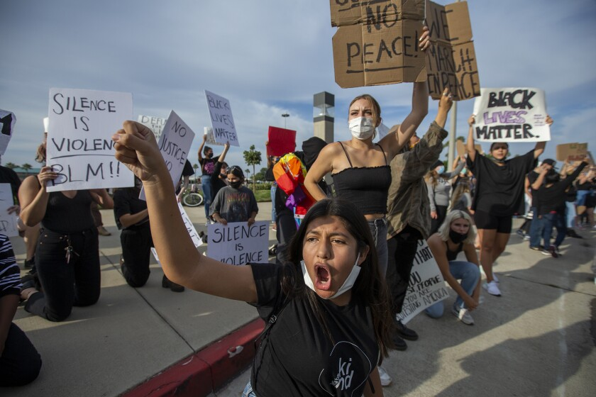 Samantha Hernandez, 14, chants during a a peaceful demonstration near the OC Fair and Event Center on Tuesday.