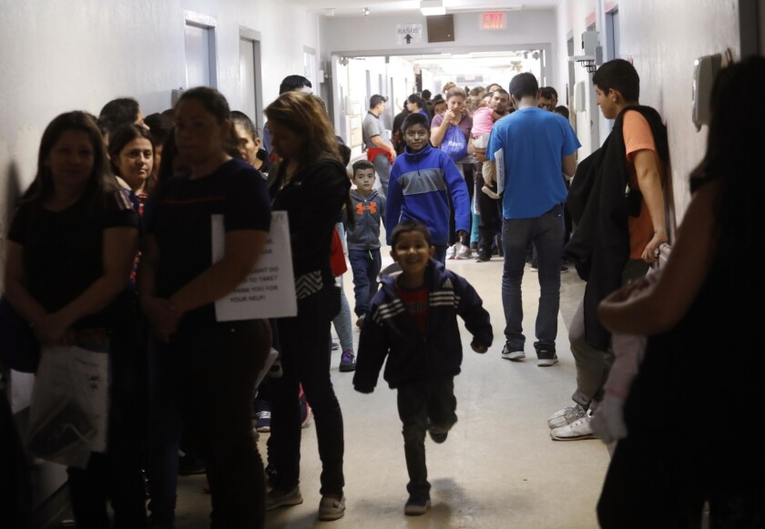 MCALLEN, TX - APRIL 3, 2019 - - Recently released migrants fill the hallways at the Catholic Chariti