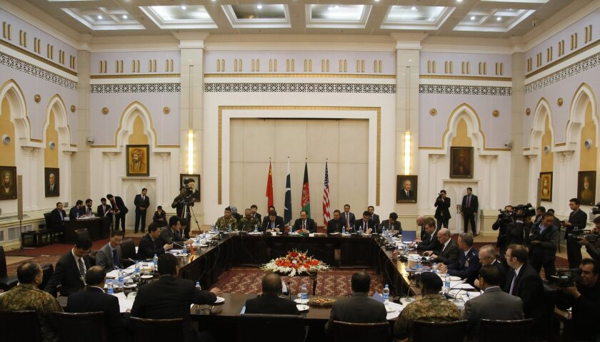 A second round of peace talks includes delegates from the U.S., Afghanistan, Pakistan and China at the presidential palace in Kabul, Afghanistan, on Monday. Representatives from the Taliban did not attend.