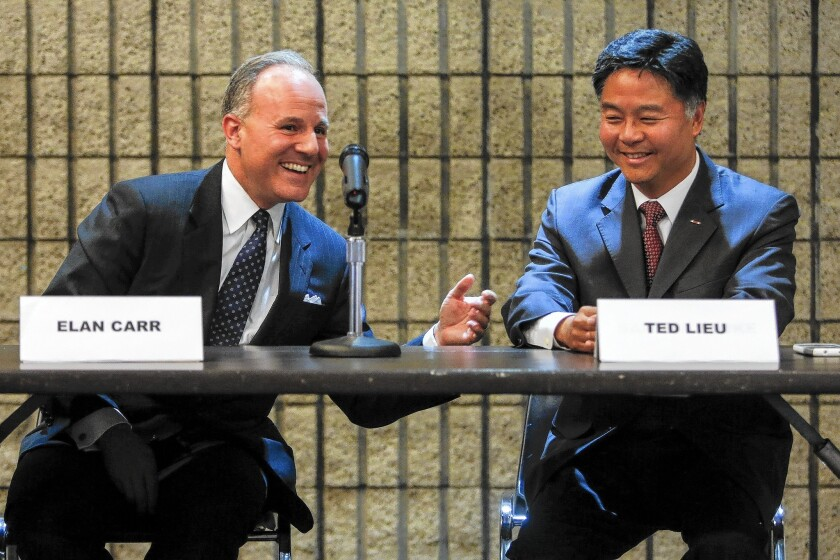 Gang prosecutor Elan Carr, left, and state Sen. Ted Lieu in a candidates forum Oct. 8.