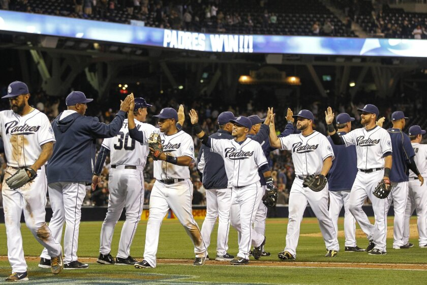 The Padres' celebrate after their 5-1 win over the Diamondbacks.