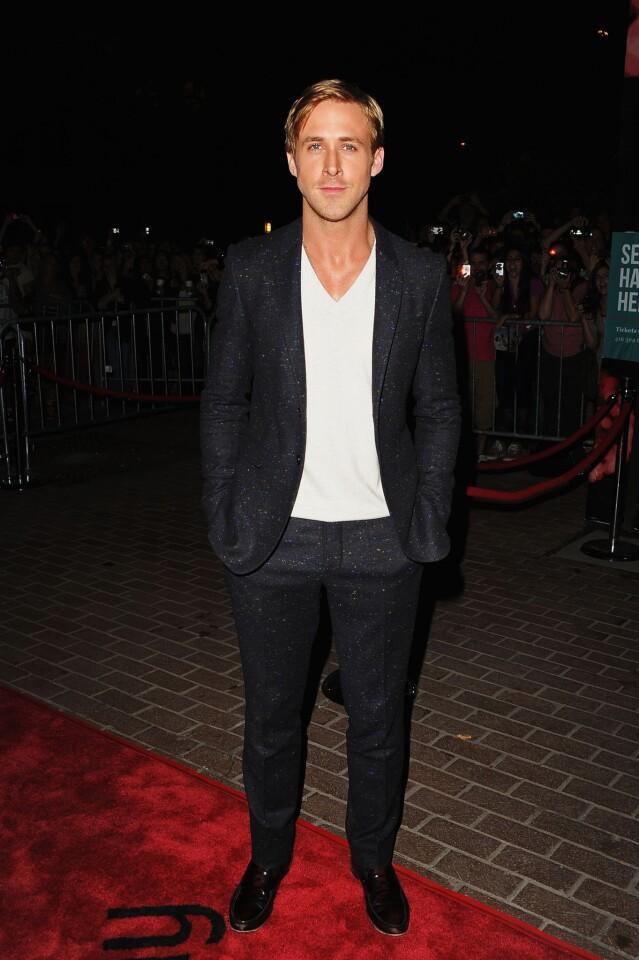 Ryan Gosling wears a dark blue Donegal wool tweed suit by Burberry Prorsum.