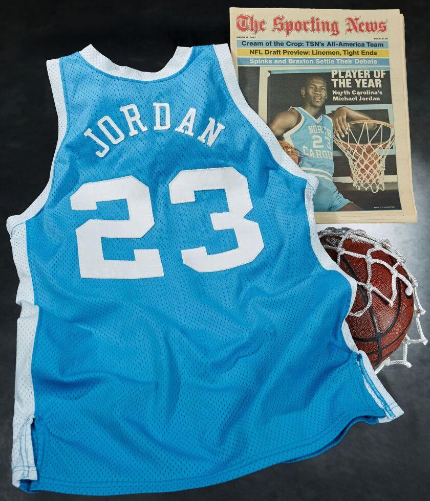 A Michael Jordan North Carolina jersey with Sporting News cover