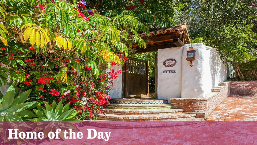 This gated, three-acre Malibu Canyon retreat offers an authentic taste of Spanish Colonial architecture and lush, grounds with mature landscaping, pool and spa.