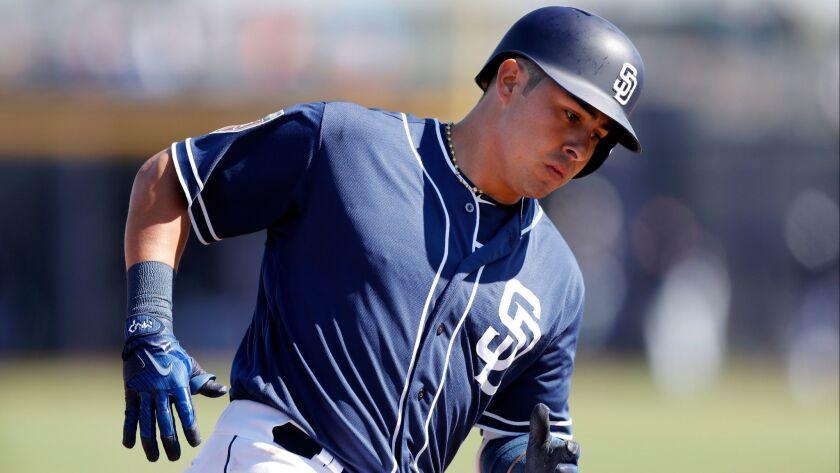 Padres third baseman Christian Villanueva rounds third base after hitting one of his two home runs this spring.