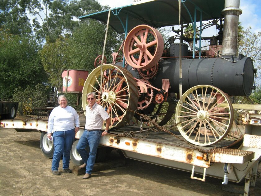 Marion Francis and Rod Groenewold with Rube Nelson's 1895 Russell steam tractor at the Antique Gas & Steam Engine Museum in Vista on Oct. 10. Francis is the museum's volunteer fundraiser and Groenewold is the museum's longtime director. CREDIT: Pam Kragen