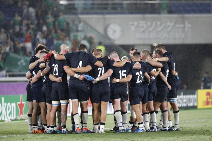 Scotland's player gather after the Rugby World Cup Pool A game at International Stadium between Ireland and Scotland in Yokohama, Japan, Sunday, Sept. 22, 2019. (AP Photo/Eugene Hoshiko)
