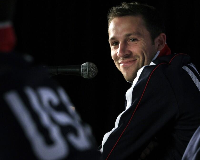 U.S. national soccer defender Steve Cherundolo smiles during a news conference.