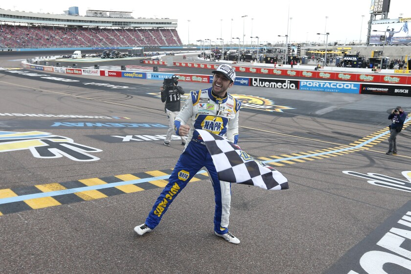 Chase Elliott celebrates at the finish line after winning the 2020 NASCAR Cup championship.