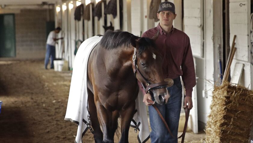 Kentucky Derby favorite Omaha Beach is walked in his barn after a workout at Churchill Downs on April 30.
