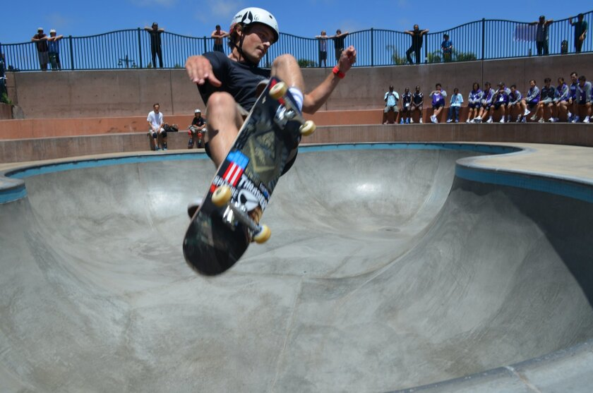 Pro skateboarder Zach Miller catches air at the Encinitas Skate Plaza as Special Olympics delegates watch. The Special Olympics World Games kicked off July 25 in Los Angeles and ends Aug. 2.
