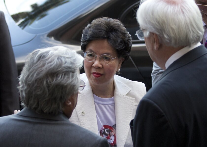 Director General of the World Health Organization Margaret Chan, center, listens to Paulo Gadelha, President of the Oswaldo Cruz Foundation, Brazil's premier state-run research institute for tropical diseases, left, in Rio de Janeiro, Brazil, Wednesday, Feb. 24, 2016. Chan is on a two-day visit to Brazil. (AP Photo/Silvia Izquierdo)
