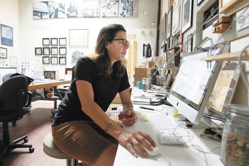 Artist Lynne Susholtz in her North Park studio.