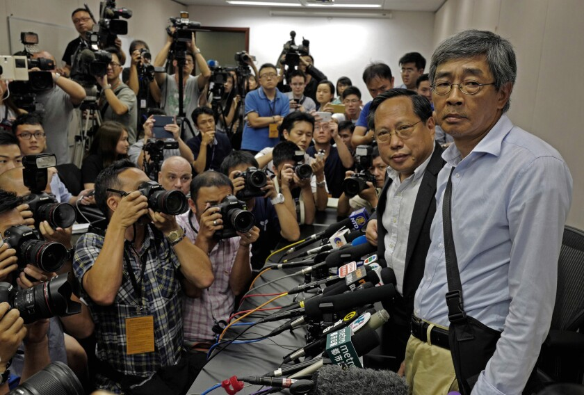 Freed bookseller Lam Wing Kee, right, is accompanied by pro-democracy lawyer Albert Ho, second from right, at a news conference in Hong Kong on June 16, 2016.