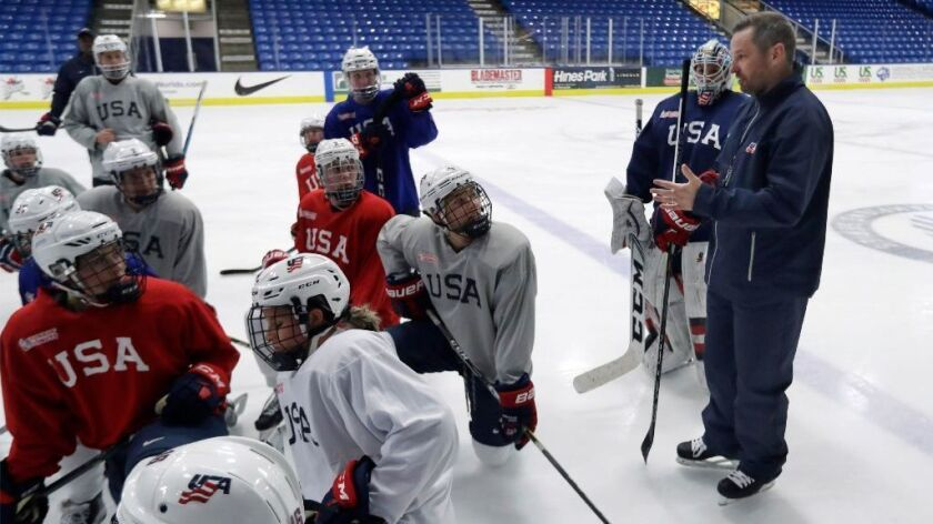 Team USA Coach Robb Stauber talks to his players during a practice session in Plymouth, Mich., on Dec. 15, 2016.