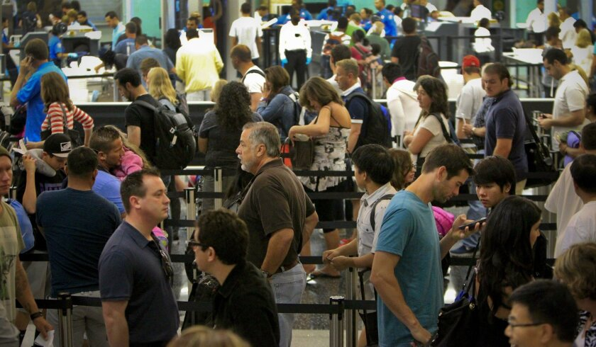 Security at Lindbergh Field's Terminal 2 begins inside the building, where passengers queue up at the TSA.