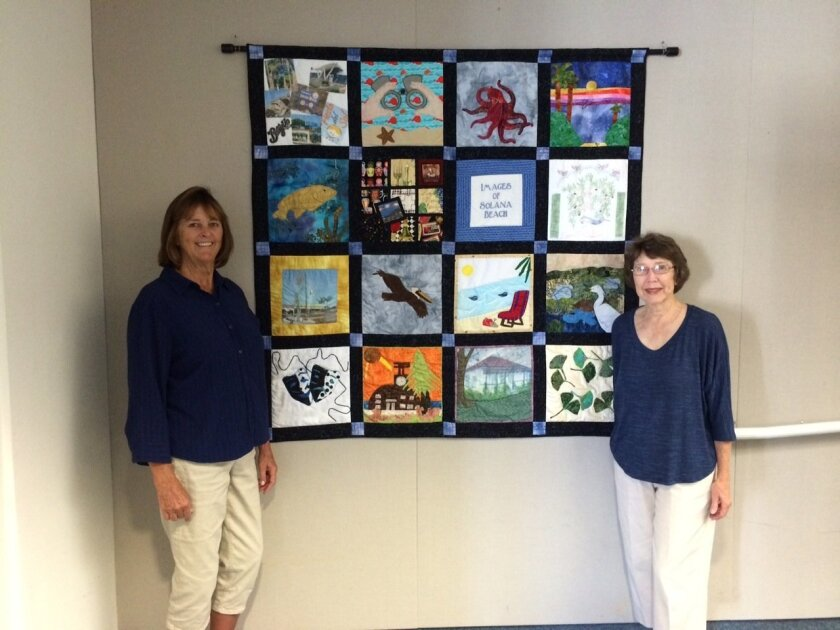 (L-R) Lenore Dale and Pam Dalton with the special quilt.