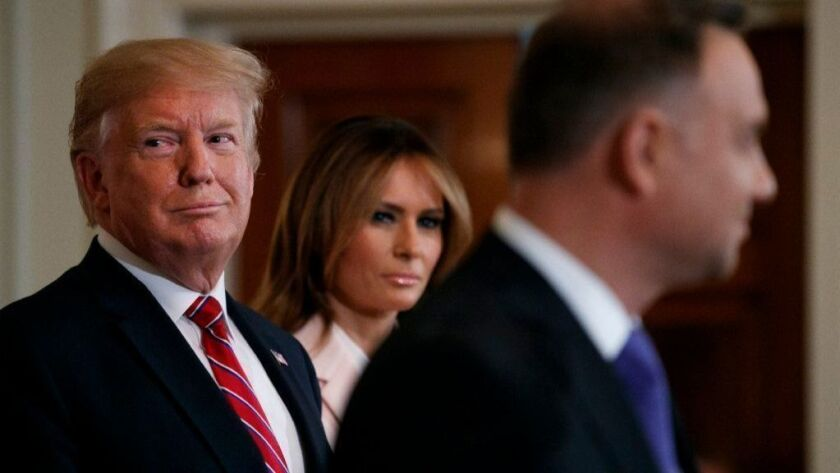 President Trump and First Lady Melania Trump attend a Polish-American reception with Polish President Andrzej Duda on June 12.