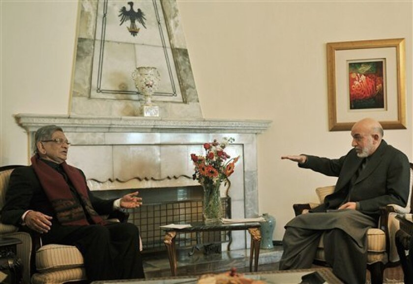 Afghan President Hamid Karzai, right, gestures as he speaks with Indian Foreign Minister S.M. Krishna at the Presidential Palace in Kabul, Afghanistan, Sunday, Jan. 9, 2011. (AP Photo/Massoud Hossaini, Pool)