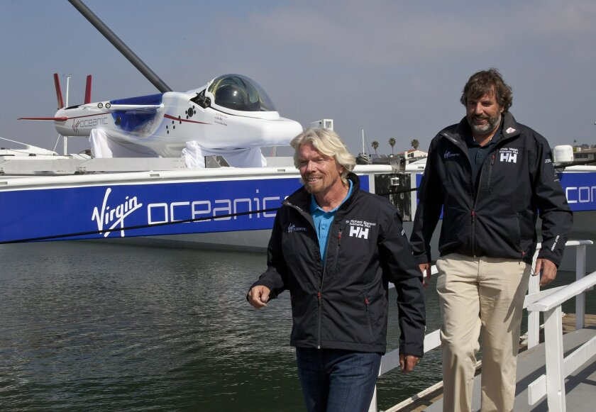 Richard Branson, co-founder of Virgin Oceanic, walks in front of the Challenger sub that he and co-founder Chris Welsh plan to take to the ocean's deepest spots in the name of science and adventure.