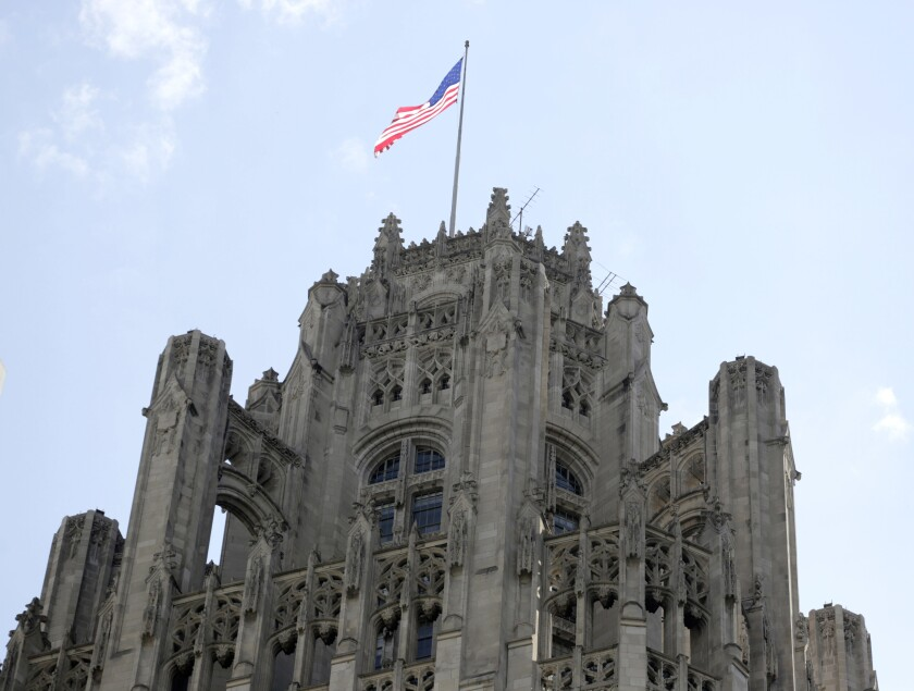 FILE - This April 25, 2016, file photo shows the top of the Tribune Tower on Michigan Avenue in Chicago. Two top executives at newspaper publisher Tribune are stepping down as the company deals with its largest shareholder, a hedge fund known for cutting newsroom jobs, and navigates the ongoing shift to online media, the Chicago-based company said in a statement Monday, Feb. 3. 2020. (AP Photo/M. Spencer Green, File)