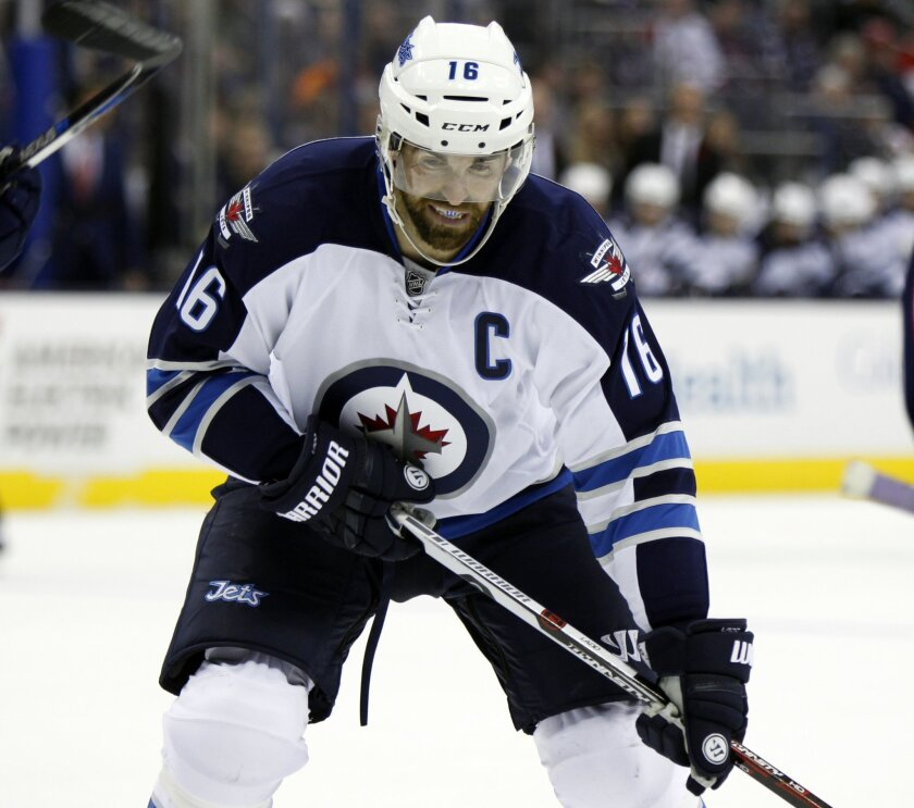 FILE - In this Oct. 31, 2015, file photo, Winnipeg Jets' Andrew Ladd is shown during an NHL hockey game against Columbus Blue Jackets  in Columbus, Ohio. Ladd is among the best players expected to be available at the NHL trade deadline. (AP Photo/Paul Vernon, File)