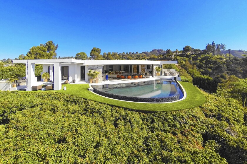 """""""Minecraft"""" creator Markus Persson, a Swedish tech billionaire, forked over $70 million in December for this custom mansion in Beverly Hills. It's fitted with iPad-controlled fountains, vodka and tequila bars, a $200,000 candy room and an onyx dining table for 24."""
