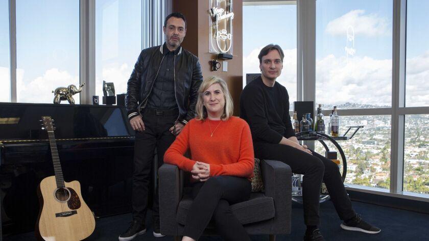 LOS ANGELES, CA-March 14, 2018: Music label BMG's (L-R) Zach Katz, Kathy Daum, and Justus Haerder ar