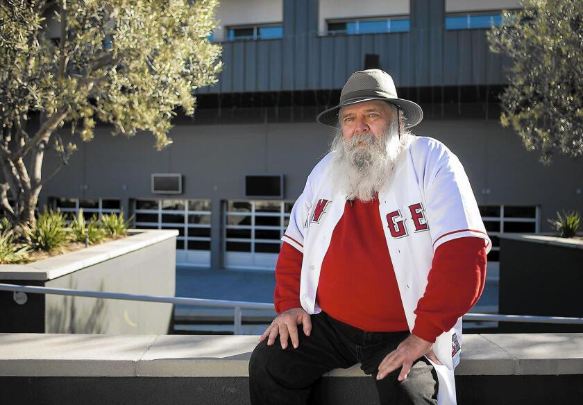 "Robert Morse, also known as ""Santa Bob"" or ""Angel Bob,"" used to be homeless but now runs the check-in center at The Crossing Church in Costa Mesa, which provides space for homeless people to store their belongings."