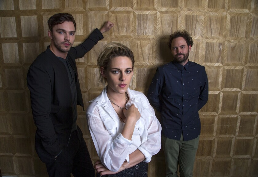 """Nicholas Hoult, left, and Kristen Stewart star in """"Equals,"""" the sci-fi romance directed by Drake Doremus, far right."""
