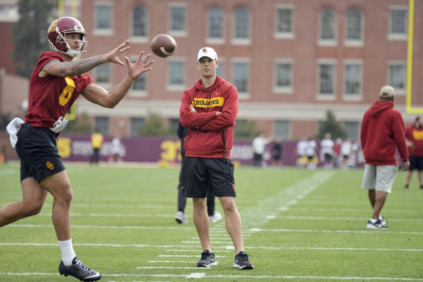 USC offensive coordinator Graham Harrell watches Michael Pittman during USC football practice.