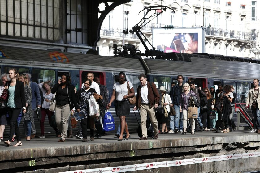 Commuters walk on a platform at the Gare St Lazare station in Paris, Wednesday, June 11, 2014, as French rail workers strike to protest against plans to open the railways to competition. French commuters faced crowded trains Wednesday morning as a strike sharply reduced capacity, and a protest by taxi drivers in at least three European countries threatened to spread the misery. (AP Photo/Thibault Camus)
