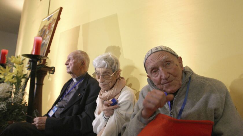 Brother Jean-Pierre Schumacher, right, last survivor of a hostage-taking of monks in 1996, at a spiritual vigil Dec. 7 in the Roman Catholic Cathedral of St Mary in Oran, Algeria.