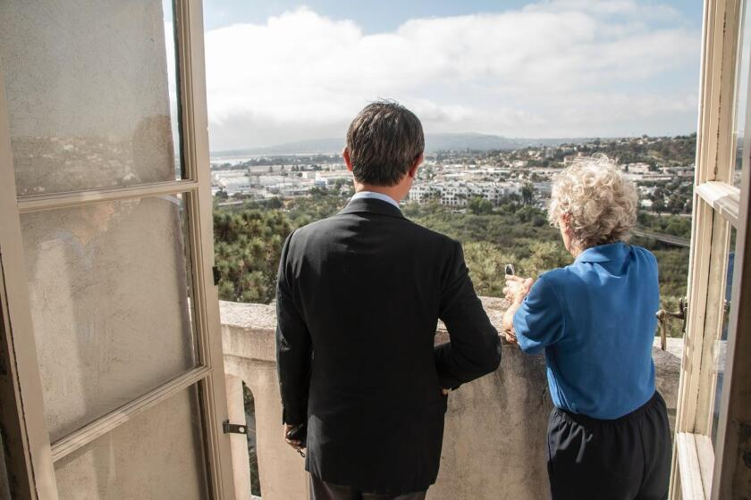Visitors admire views of the San Diego River from the top floor of the Junípero Serra Museum on July 16, 2019.