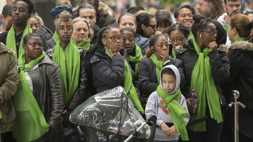 Families of victims of the Grenfell Tower disaster attend a service of remembrance in west London, T