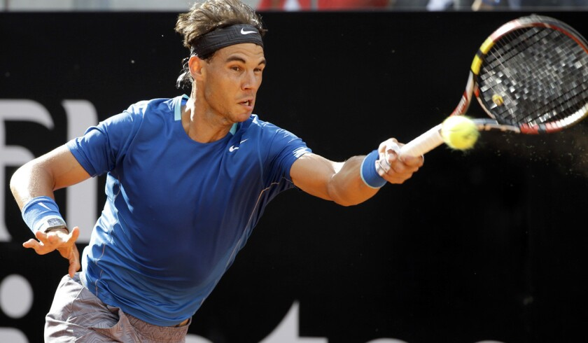 Rafael Nadal tracks down a shot in a victory over Mikhail Youzhny on Thursday at the Italian Open in Rome.