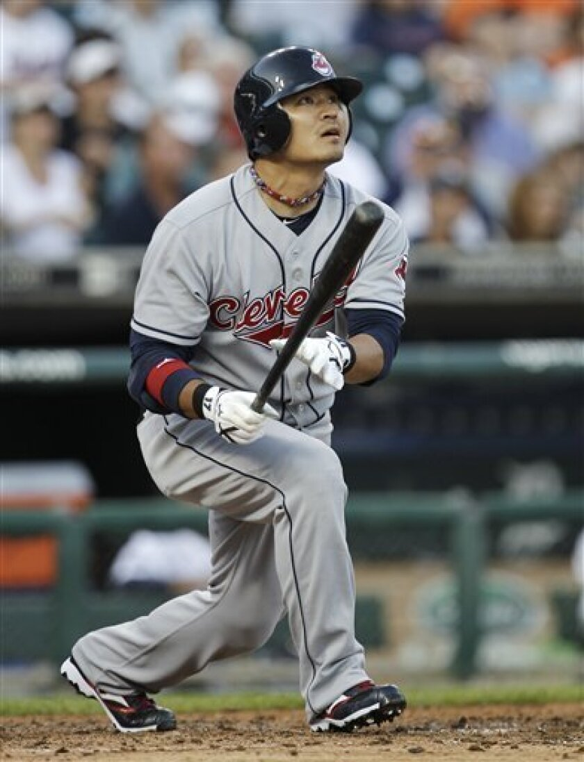 Cleveland Indians' Shin-Soo Choo, of South Korea, watches his solo home run against the Detroit Tigers in the sixth inning of a baseball game in Detroit Tuesday, June 1, 2010. (AP Photo/Paul Sancya)