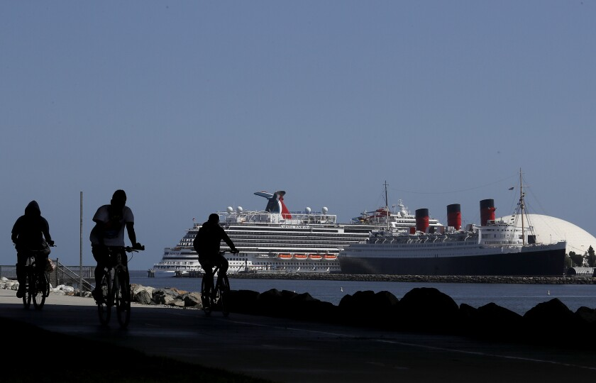 Cyclists have the bike path to themselves Friday along the shoreline in Long Beach.