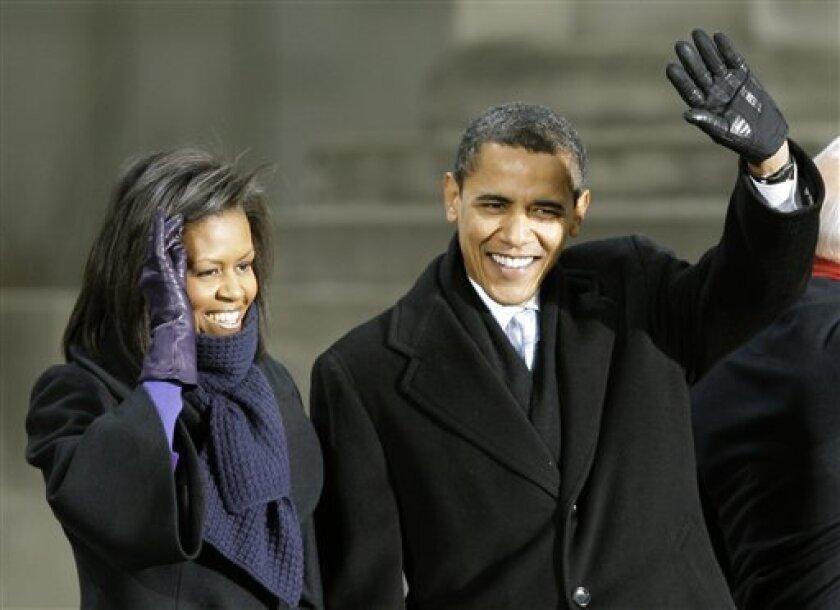 Michelle Obama, left with her husband, President-elect Barack Obama, wave at War Memorial Plaza in Baltimore Saturday, Jan. 17, 2009.(AP Photo/Alex Brandon)
